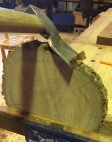 Hatchet removes the bark